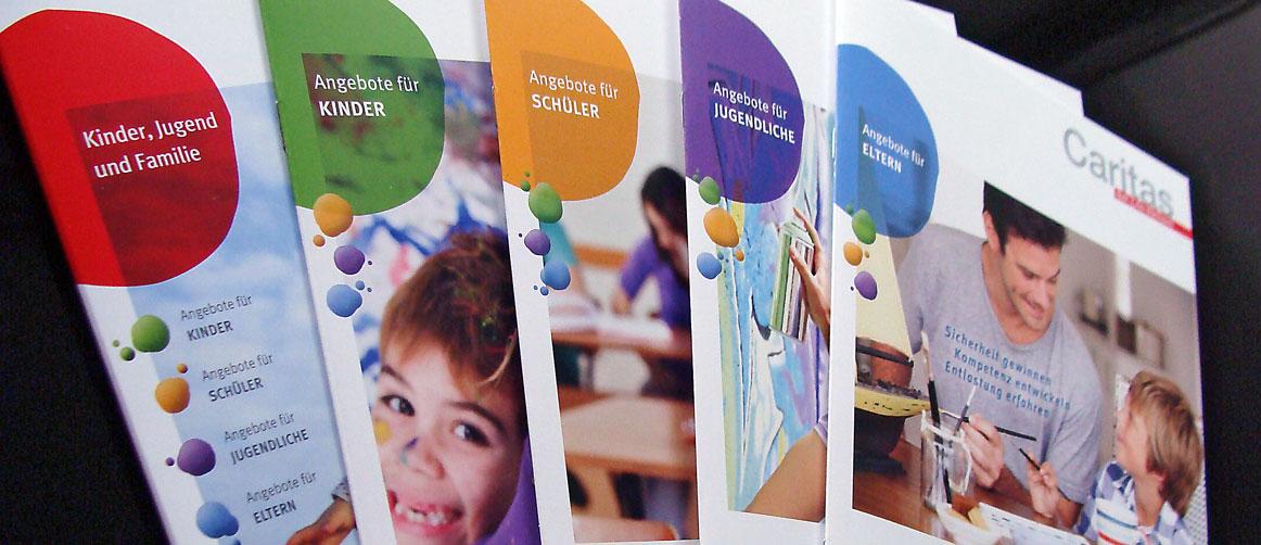 Mappe und Broschüren für Handlungsfeld Kinder, Jugend und Familie der Caritas München und Freising